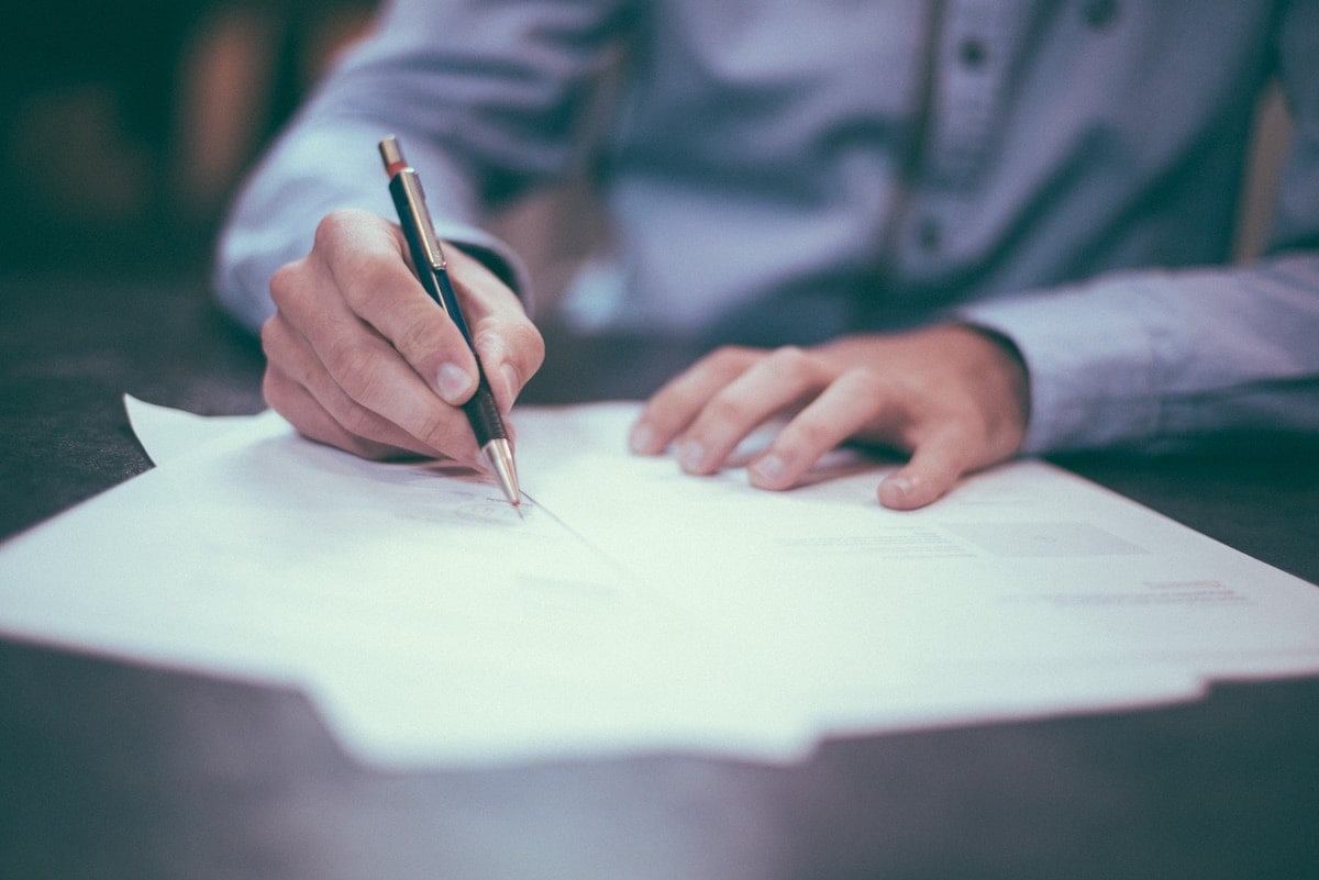 A man signing papers