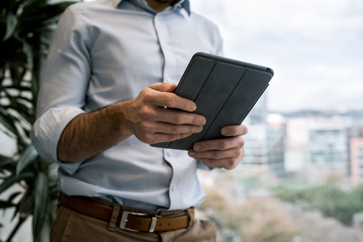 A man reading an article on his tablet